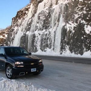 Seward Highway between Anchorage & Girdwood, AK with frozen waterfalls in the background